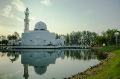 Tengku Tengah Zaharah Mosque. Silhouette picture of Tengku Tengah Zaharah with crystal clear reflection. this mosque located in Kuala Ibai, Terengganu, Malaysia Stock Photo