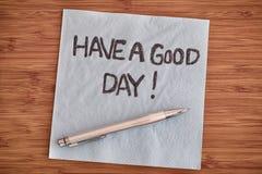 Tenha um bom dia! Escrita em um guardanapo Fotografia de Stock