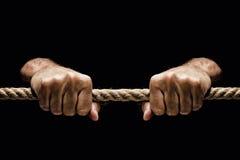 Tenir la corde serrée Photographie stock libre de droits