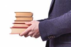 Tenir la pile des livres Images stock