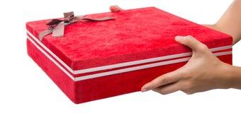 Tenir le boîte-cadeau rouge VI Photo stock