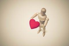 Tenir le coeur rouge Image stock