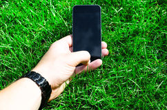 Tenir le téléphone Photographie stock libre de droits