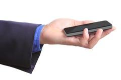 Tenir le téléphone intelligent avec le chemin de coupure Image stock