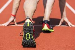 Tenisówka biegacza początku pozycja Obraz Stock