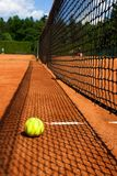 Tennis ball on court Royalty Free Stock Photos