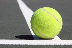 Tenis ball on white line. Close up of tennis ball on white line Stock Photo