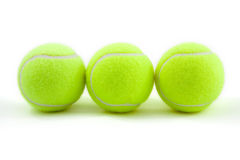 Tenis balls. Tenis ball on white background. lying by line Royalty Free Stock Photography