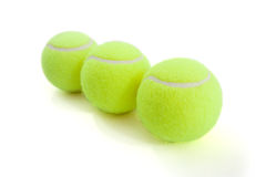 Tenis balls. Tenis ball on white background. lying by line Royalty Free Stock Images
