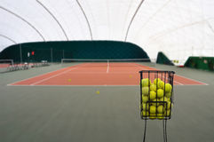 Tenis court and balls Stock Images
