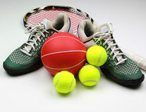 Tenis gear, shoes, racket, balls. The basic equipment need for the fun game of tennis Stock Image