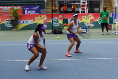 Tenis. Indonesian women's doubles tennis players compete in ITF women's circuit in the city of Solo, Central Java, Indonesia Stock Photos