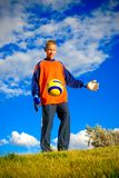 Tenn and soccer. Teen plays soccer outside on grass Royalty Free Stock Images