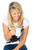 Tennage girl with cup. Teenage girl with cup. Isolated on white background Royalty Free Stock Photography