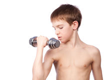 Tennager holds dumbbell Stock Image