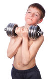 Tennager lifts heavy dumbbell Stock Image