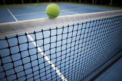 Tennes ball over black net Royalty Free Stock Photo