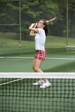 Tennis. Model Release 351 Woman in early 20s playing tennis royalty free stock photos