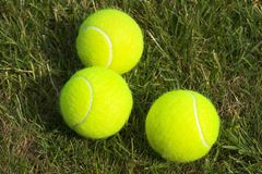 Tennis. Balls laid out on grass stock photos