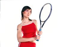 Tennis. Girl playing tennis and holds racket with two hands Stock Image