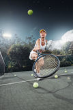 Tennis. Portrait of young beautiful woman playing tennis in summer environment Royalty Free Stock Photography