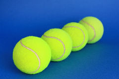 Tennis. Balls on a blue background Royalty Free Stock Photo