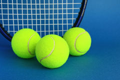 Tennis. Balls on a blue background Stock Images