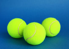 Tennis. Racket and balls on a blue background Stock Photography