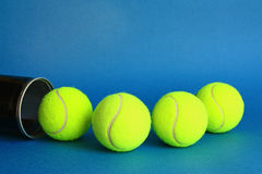 Tennis. Balls on a blue background Royalty Free Stock Image