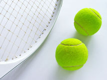 Tennis. Ball and racket on the white background Stock Photography