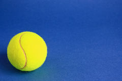 Tennis. Ball on a blue background Stock Photography