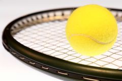 Tennis. Racquet and ball isolated on a white background stock images