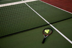 Tennis. A shot of a tennis racquet and tennis balls on a tennis court Stock Photography