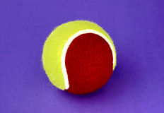 Tennis. Ball on a purple background Royalty Free Stock Photography