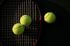 Tennis. A shot of tennis racquet and tennis balls on a tennis court Royalty Free Stock Photos
