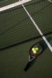 Tennis. A shot of a tennis racquet and tennis balls on a tennis court Stock Photo