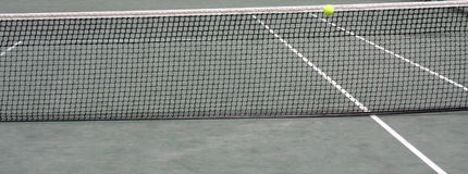 Tennis. Ball against the net Royalty Free Stock Photo