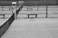 Tennis. Courts with the umpire chairs all in a row, in black and white Royalty Free Stock Images