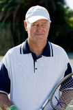Tennis. Close up of a senior male tennis player holding a racquet Stock Photo
