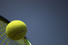 Tennis. Competition -  racket and yellow  ball sky blue stock images