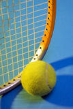 Tennis. Detail of a tennis racquet and a tennis ball royalty free stock photo
