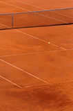 Tennis. Clay tennis court with ball flying across it Royalty Free Stock Images