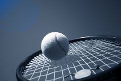 Tennis. Summer tennis. Tennis Competition - Tennis racket and tennis ball sky blue stock photo
