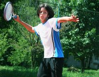 Tennis. Teenager in action playing tennis Royalty Free Stock Image