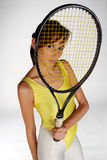Tennis Act. A Girl looking through a tennis racket Royalty Free Stock Image