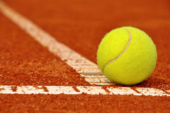 Tennis background. Tennis ball on a tennis clay court Royalty Free Stock Image