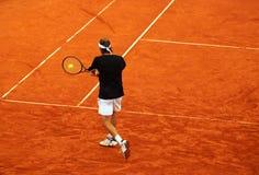 Tennis backhand. Tennisplayer playing backhand on the baseline stock image