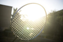 Tennis badminton racket under rays of sun glare bloom Royalty Free Stock Photography