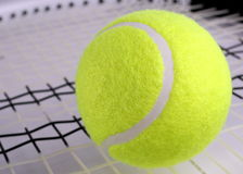 Tennis bal on racket Stock Photo