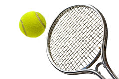 Tennis bal and racket. A shot of a tennis racket hitting a tennis ball Stock Images